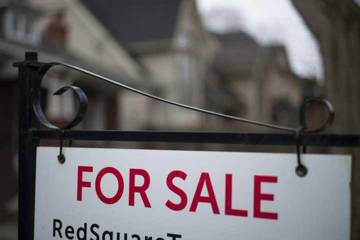 A home for sale sign is shown in a Toronto west-end neighbourhood May 8, 2020.