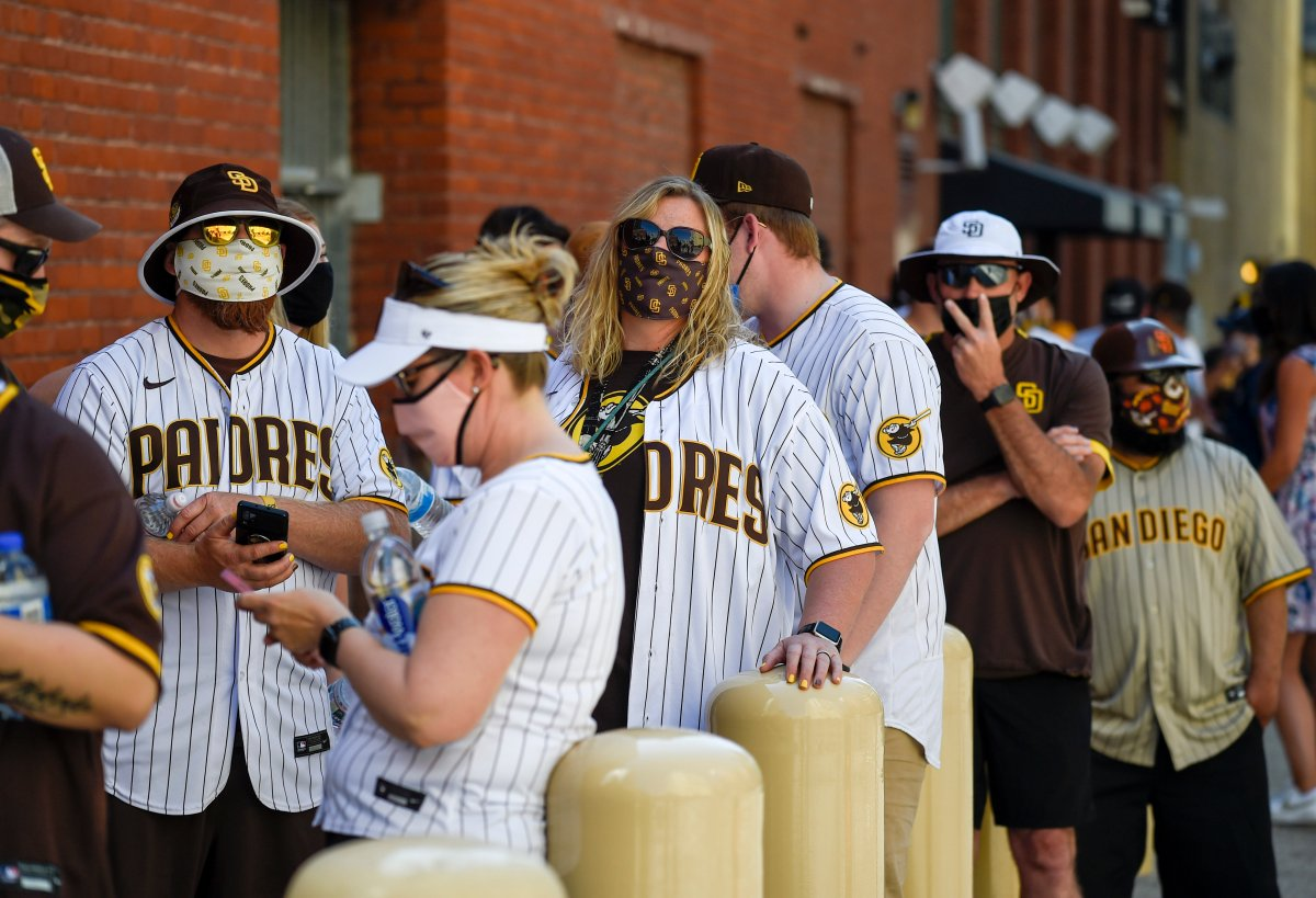 Baseball fans wait in line before the gates opened up before a baseball game between the Arizona Diamondbacks and the San Diego Padres Thursday, April 1, 2021, on opening day in San Diego.