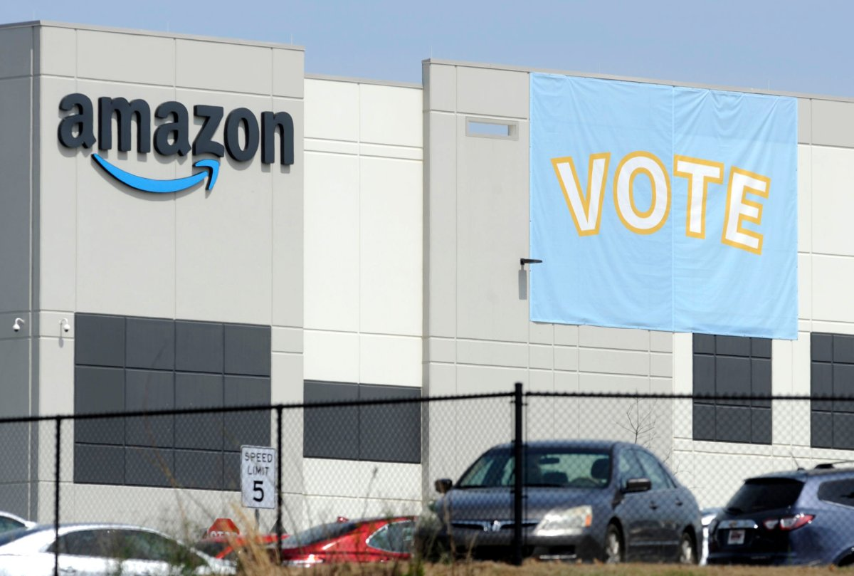 FILE - In this Tuesday, March 30, 2021 file photo, a banner encouraging workers to vote in labor balloting is shown at an Amazon warehouse in Bessemer, Ala.