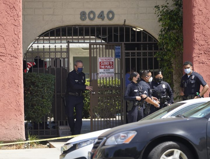 Los Angeles Police Chief Michel Moore exits an apartment complex as police investigate in Reseda, Calif., Saturday, April 10, 2021. The mother of three children — all under the age of 5 — found slain inside a Los Angeles apartment Saturday morning has been arrested, police said.  (AP Photo/Damian Dovarganes).