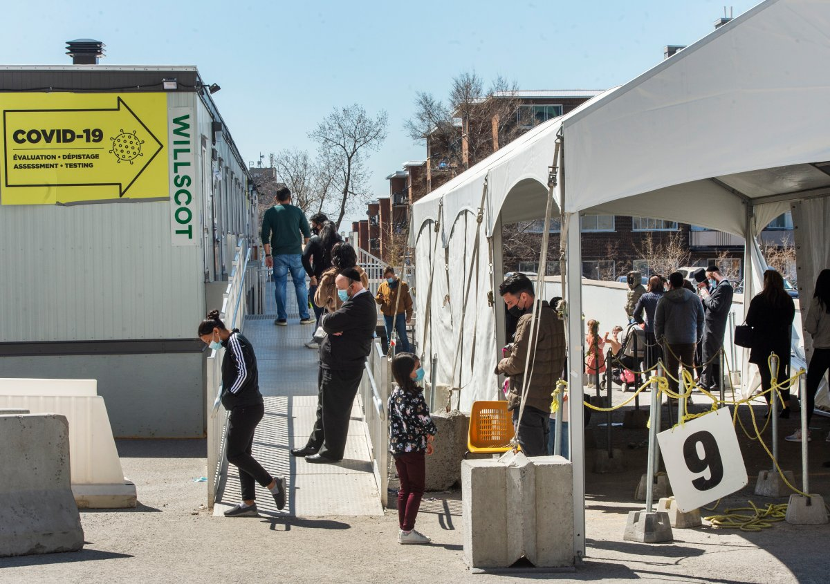 People line up at a COVID-19 testing clinic, Tuesday, April 13, 2021  in Montreal.