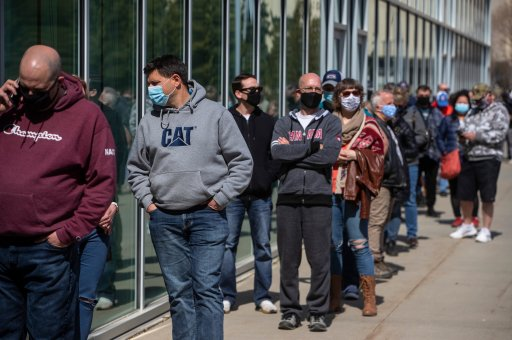 People line up outside an immunization clinic to get their Oxford-AstraZeneca COVID-19 vaccine in Edmonton on Tuesday, April 20, 2021.