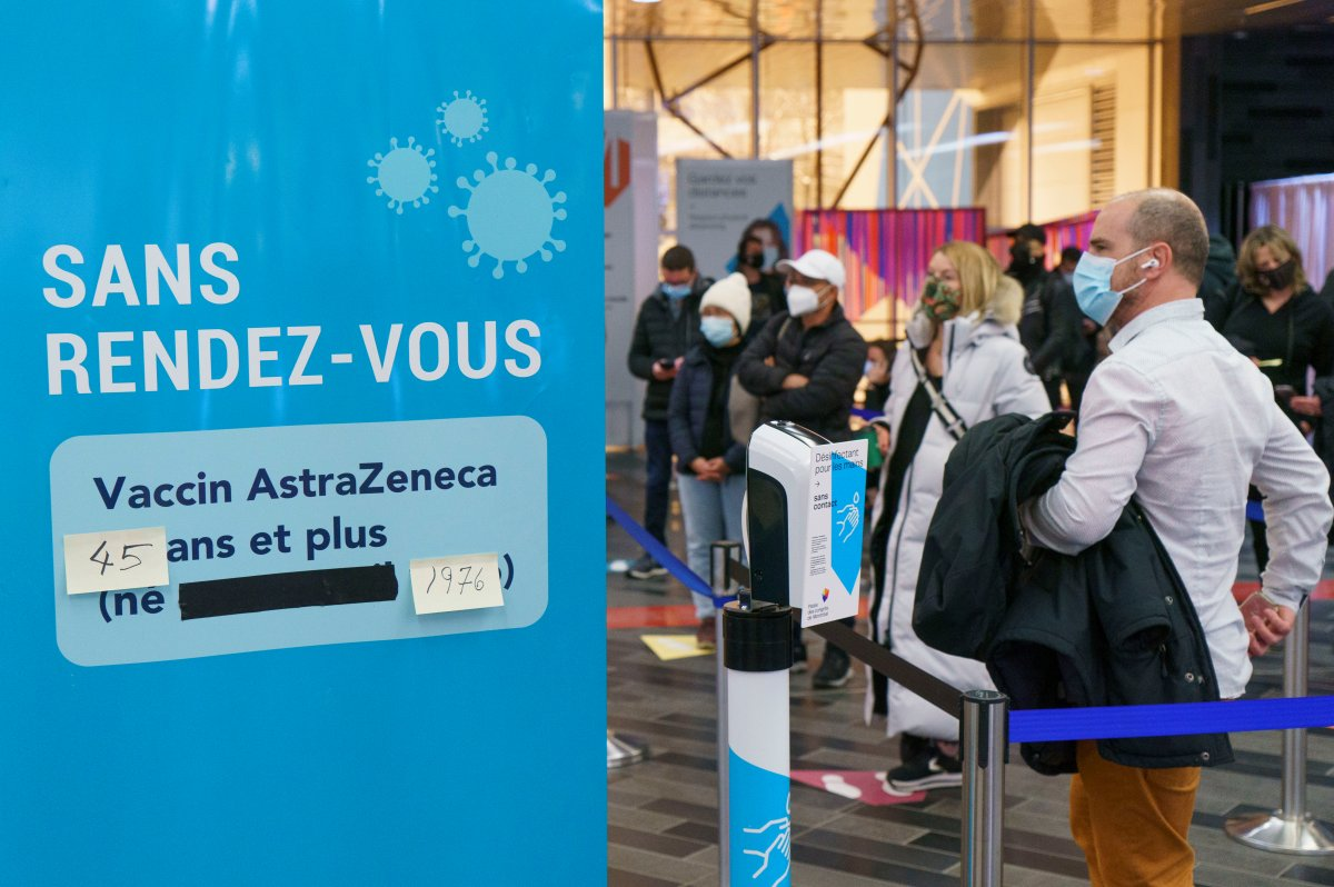 People line up at walk-in COVID-19 vaccination clinic to receive the AstraZeneca vaccine in Montreal, on Wednesday, April 21, 2021. Quebecers 45 and over can now get the AstraZeneca vaccine across the province.