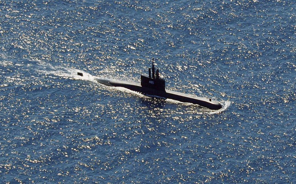 The Indonesian Navy submarine KRI Alugoro sails during a search for KRI Nanggala, which had gone missing in the waters off Bali Island, Indonesia, Thursday, April 22, 2021. (AP Photo/Eric Ireng)