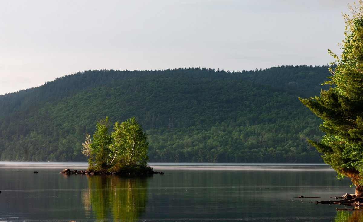 The Laurentian Mountains as seen from Drifwood Provincial Park across the Ottawa River west of Deep River, Ont, on June 9, 2018.