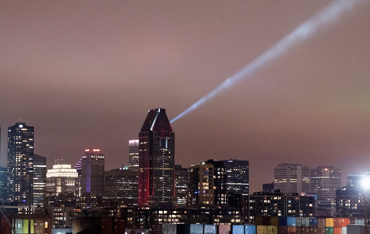 The Montreal skyline is shown shortly before curfew in Montreal, Sunday, January 10, 2021, as the COVID-19 pandemic continues in Canada and around the world.