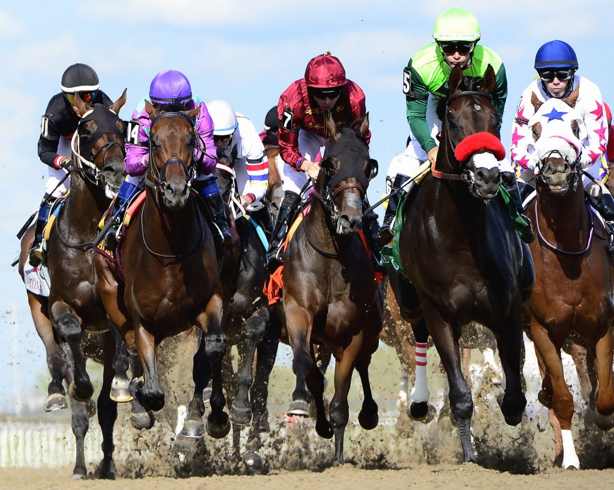 One Bad Boy, second from right, ridden by jockey Flavien Prat, rides in the pack on his way to win the Queen's Plate at Woodbine Racetrack, in Toronto on Saturday, June 29, 2019. Jim Lawson, chief operating officer of Woodbine Entertainment, is hopeful Woodbine's thoroughbred racing season will start on time but he's uncertain if the campaign will open April 18 due to the COVID-19 pandemic.