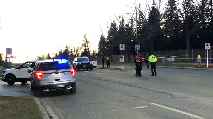 Police respond to a collision at 90 Avenue and Bay View Drive S.W. on Wednesday night.