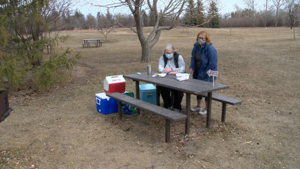 Members of the Saskatoon Rotary Club at the Forestry Farm waiting to hand out Easter goody bags.