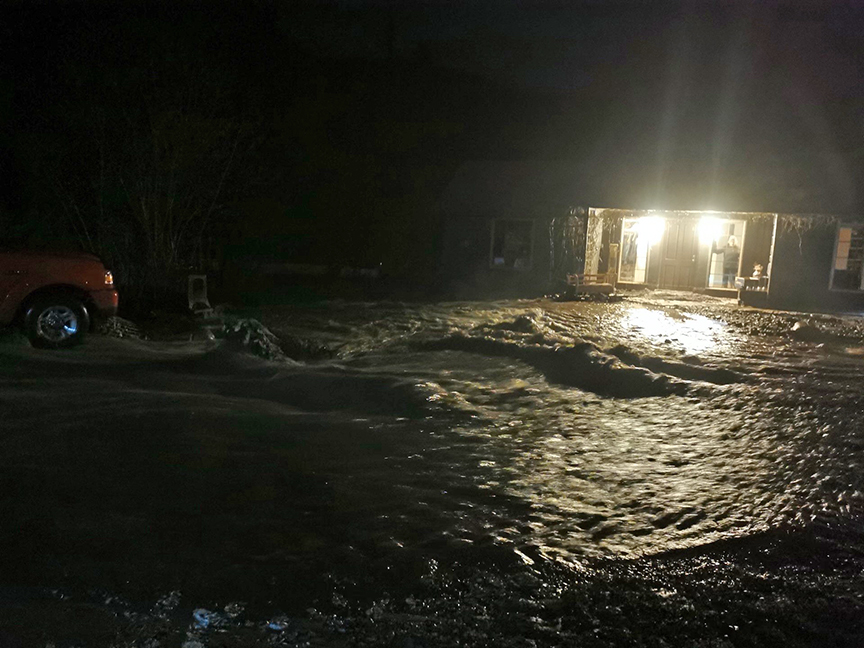 Residents of three homes on Fife Road near Christina Lake awoke in the middle of the night to water and debris inundating their properties from a nearby creek that had breached its banks.