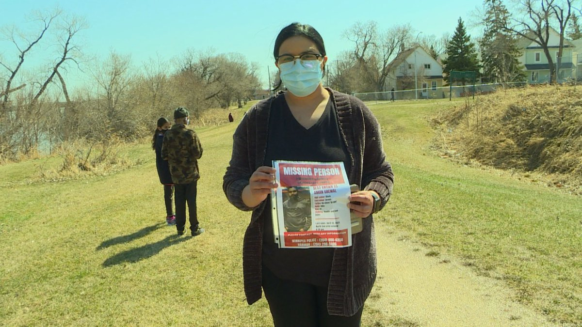 Manpreet Grewal and her family put up missing person posters and searched the banks of the Red River Thursday, looking for signs of her brother-in-law Amninder Grewal.