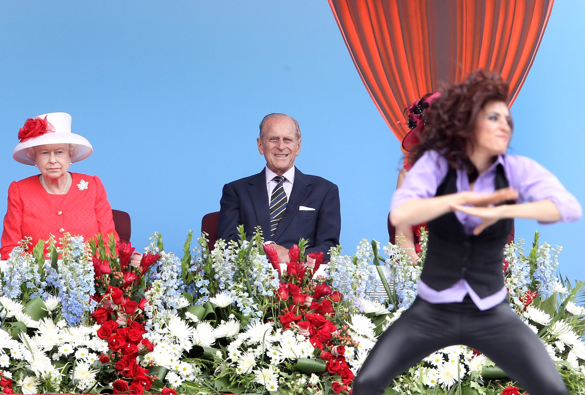 Queen Elizabeth II and Prince Philip, Duke of Edinburgh watch a dancer perform during Canada Day celebrations on Parliament Hill on July 1, 2010 in Ottawa, Canada.