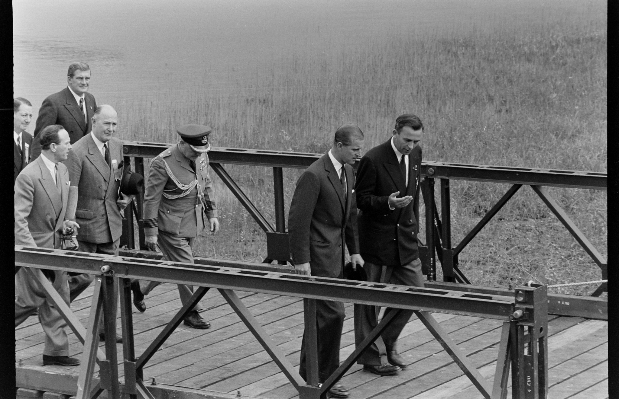 Prince Philip, Duke of Edinburgh walking on a dock during the British Empire and Commonwealth Games, Vancouver, B.C., 1954.
