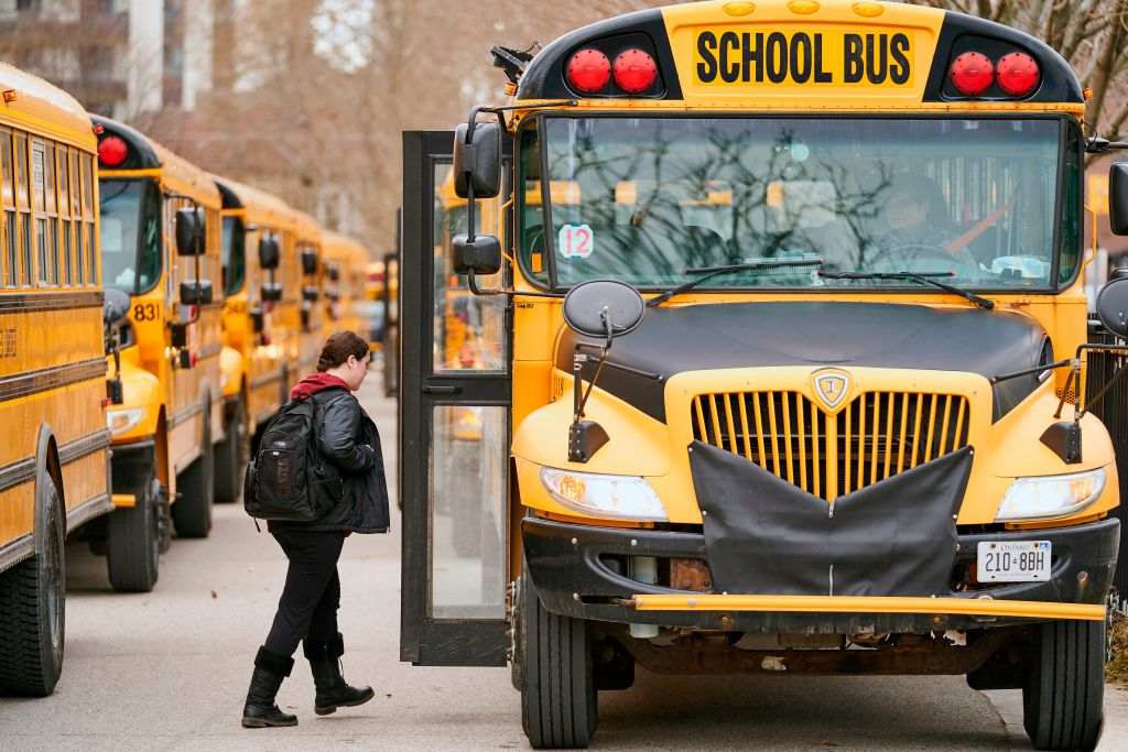 FILE - High school students leave Beal Secondary School in London, Ontario on March 13, 2020.