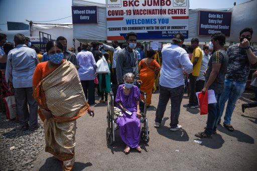 People arrive to receive their Covid-19 vaccines at a mass vaccination center on April 29, 2021 in Mumbai, India.