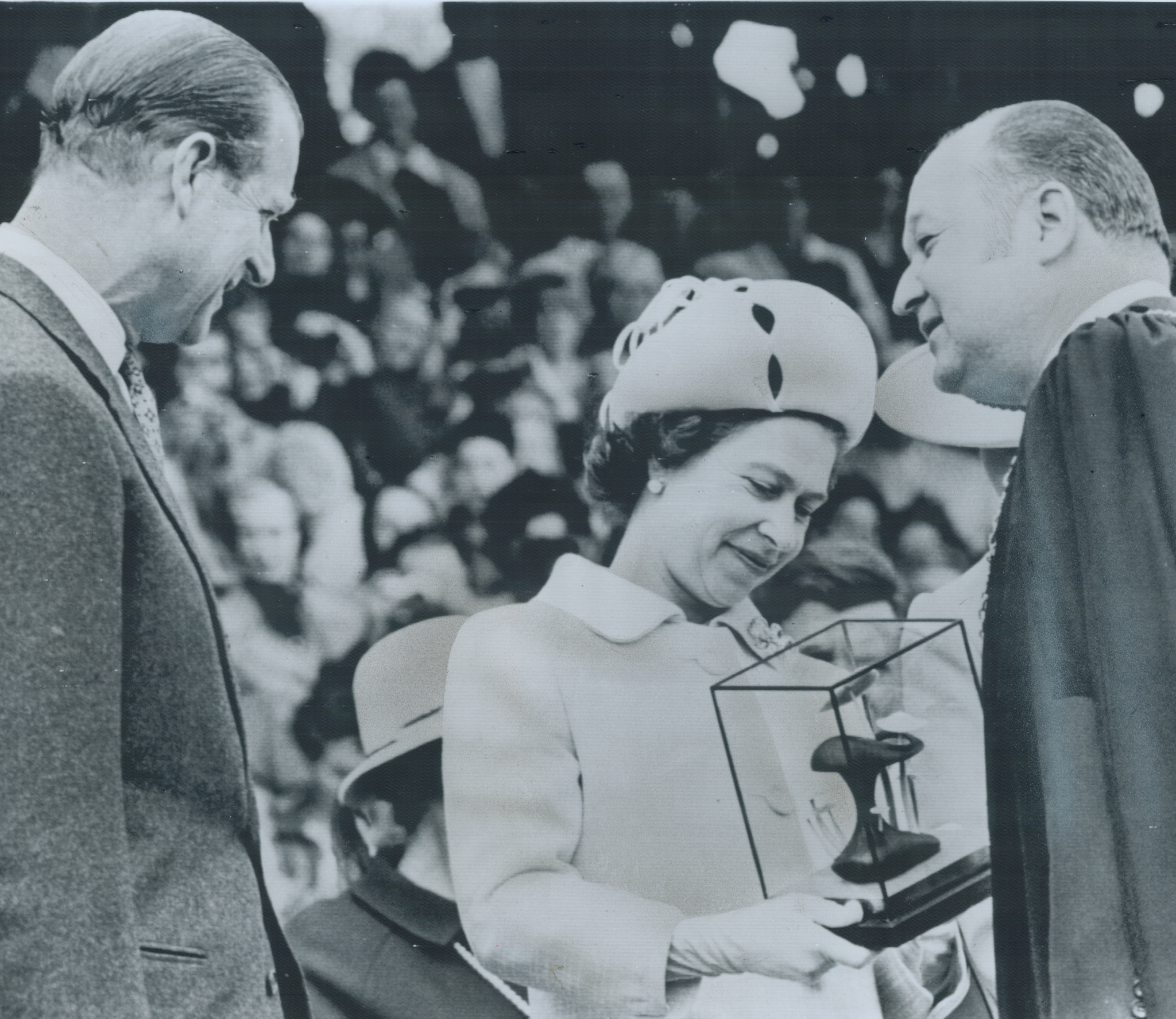 May 6, 1971: Queen Elizabeth II and Prince Philip admire a glass-enclosed sculpture presented to them by Mayor Hilbert Roth (right) during their visit in Kelowna, B.C.