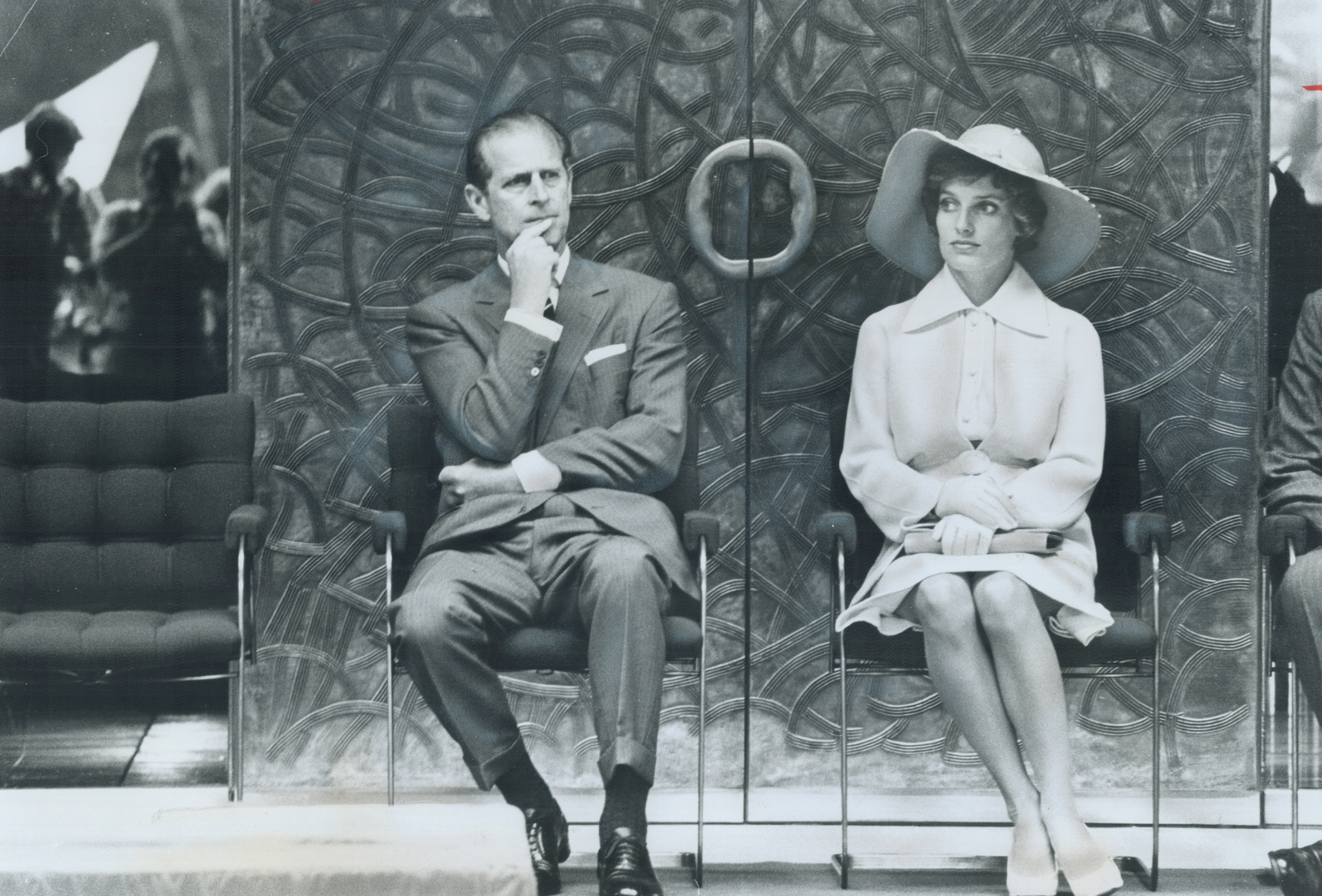 Prince Philip and Margaret Trudeau; wife of the Prime Minister, listen to the Queen as she officially opens the Lester B. Pearson external affairs building in Ottawa in 1973.