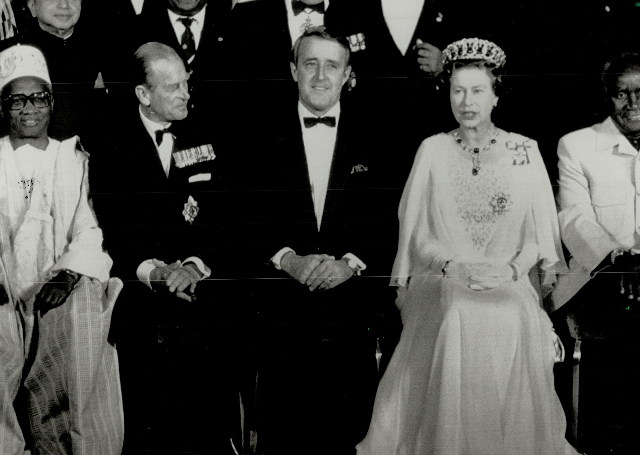 Prime Minister Brian Mulroney is flanked by the Queen and Prince Philip while posing for a group photo in Vancouver before the royal couple hosted a dinner for Commonwealth leaders.