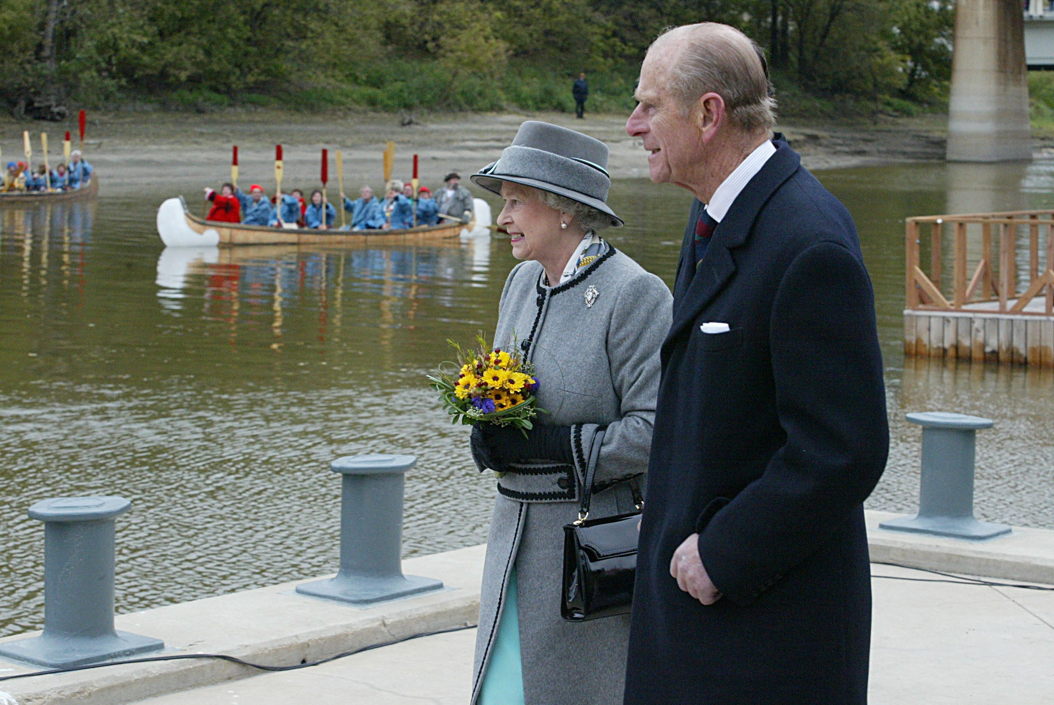 Queen Elizabeth II and the Duke of Edinburgh view ceremonies along the Red River in 2002 in Winnipeg on her 20th trip to Canada, the last stop of a year-long jubilee tour celebrating her 50-year reign.