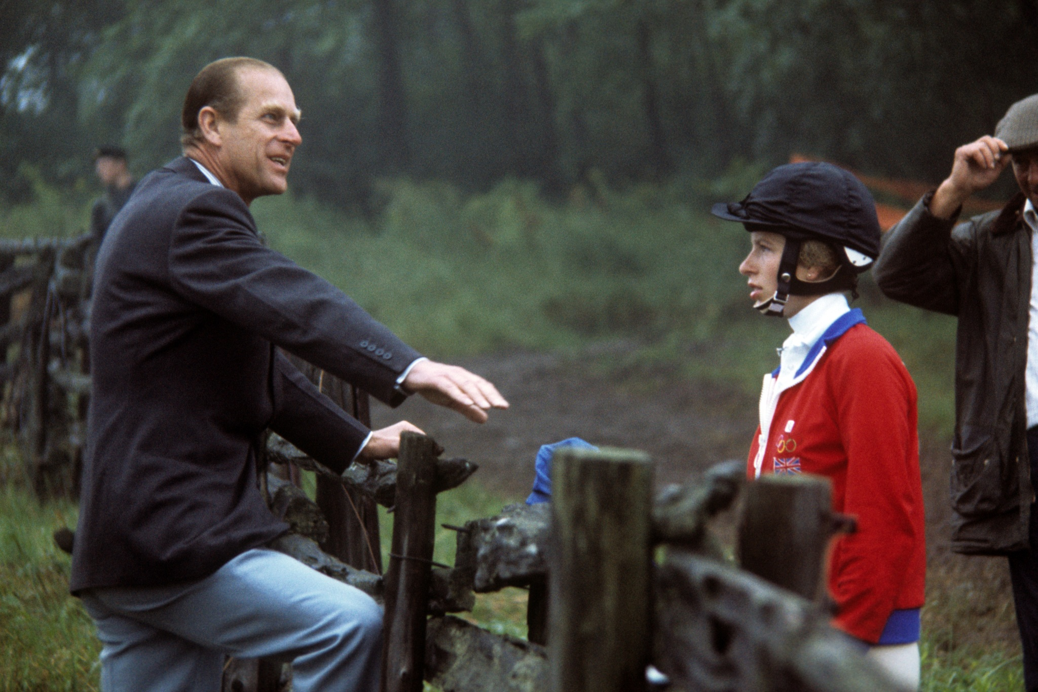 Princess Anne talking to her father, the Duke of Edinburgh, at Bromont, Que., during the cross country section of the three-day event at the Montreal Olympic Games.