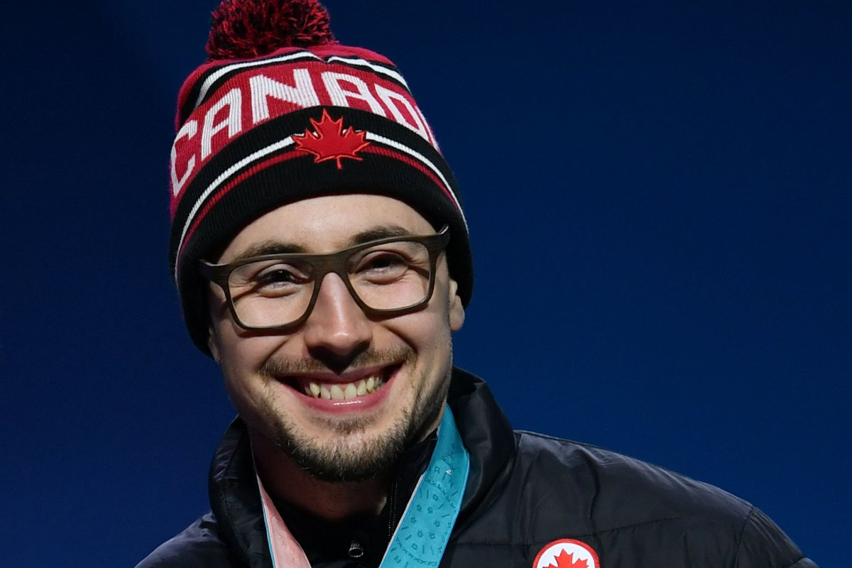 Canada gold medallist Alexander Kopacz poses on the podium during the medal ceremony for the 2-man bobsleigh at the Pyeongchang Medals Plaza during the Pyeongchang 2018 Winter Olympic Games in Pyeongchang on February 20, 2018.