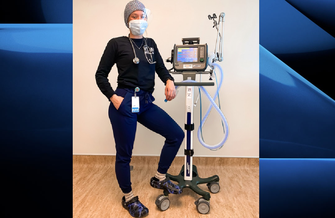 Respiratory therapist Keanna Alcock stands alongside a ventilator, a machine that has accompanied her on her journey from aspiring medical professional to a bonafide healthcare hero.