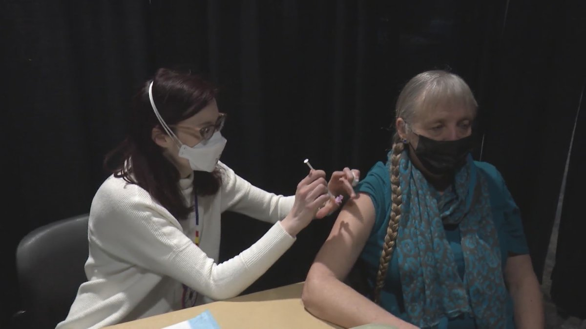 A person gets their COVID-19 shot at Calgary's second Indigenous vaccine clinic.