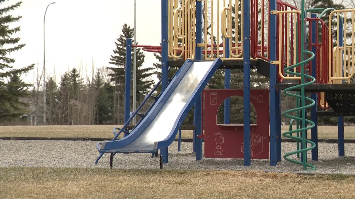 Graffiti was spray-painted on the parking lot of a playground in southwest Calgary.