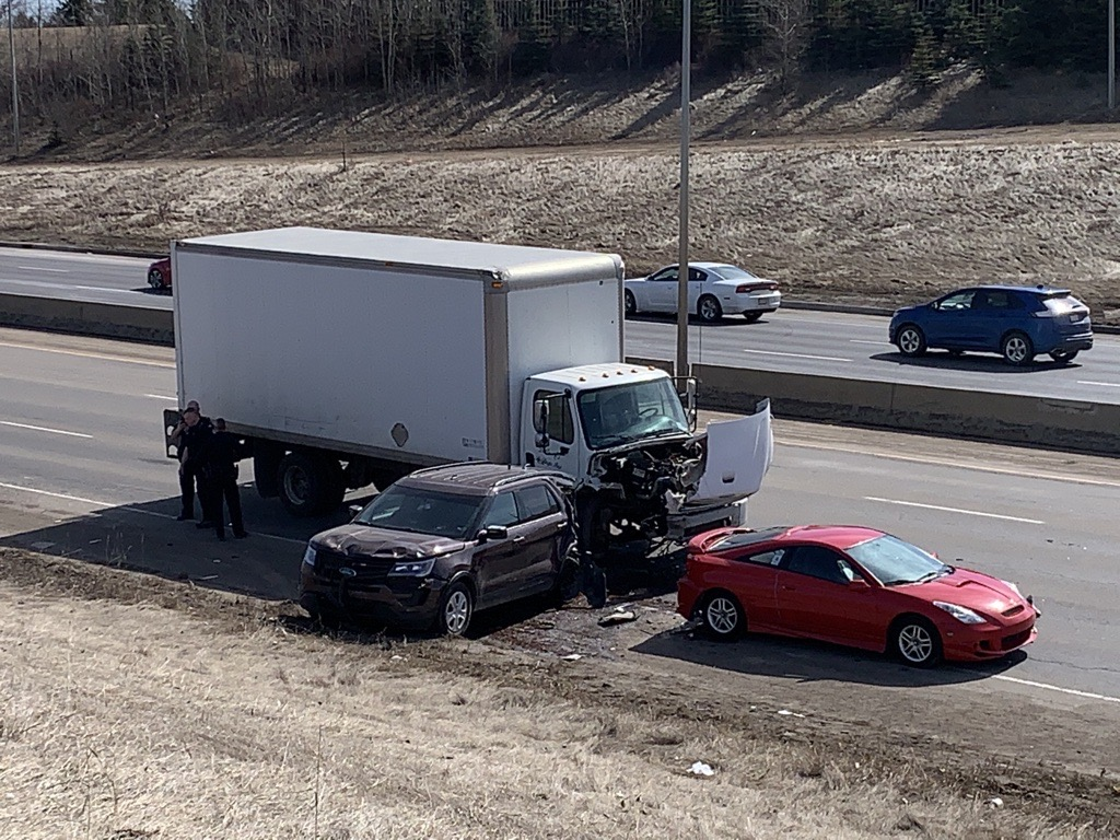 A major collision involving a police officer shut down a section of Whitemud Drive near 91 Street in southeast Edmonton on Monday, April 5, 2021.