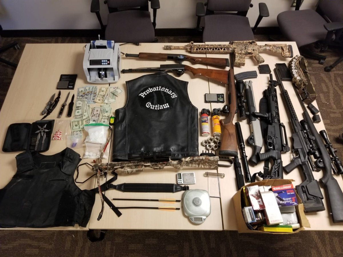After months of investigation, Kingston police, along with OPP and Durham police, made multiple arrests and seized items from several locations, including an Outlaws MC club.