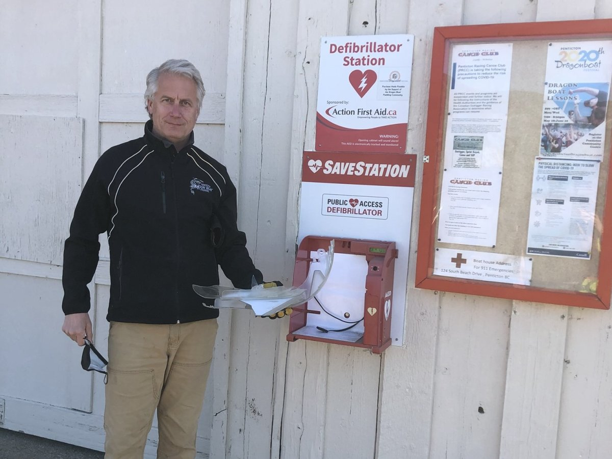 Don Mulhall, coach and race director for the Penticton Dragon Boat Festival, shows the vandalism and theft of an AED at the Skaha Lake boathouse.