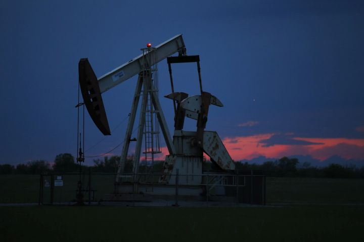 In this April 21, 2020 file photo, a pumpjack is pictured as the sun sets Tuesday, April 21, 2020, in Oklahoma City.