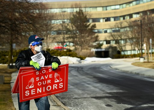 A man protests outside the Tendercare Living Centre long-term-care facility during the COVID-19 pandemic in Scarborough, Ont., on Dec. 29, 2020. The LTC home was hit hard by the coronavirus during the second wave.