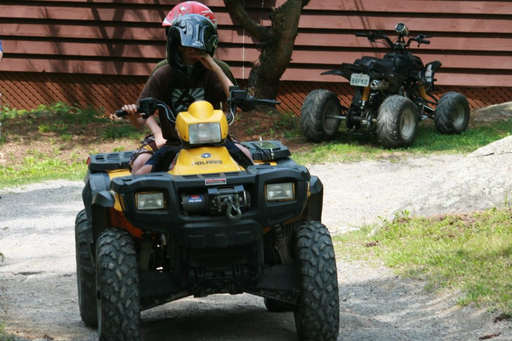 A teenager rides an ATV in this Aug. 3, 2009 file photo.