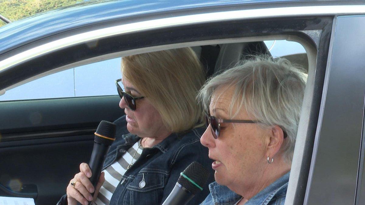 Two members of the Vernon Kalamalka Chorus  singing in their car.