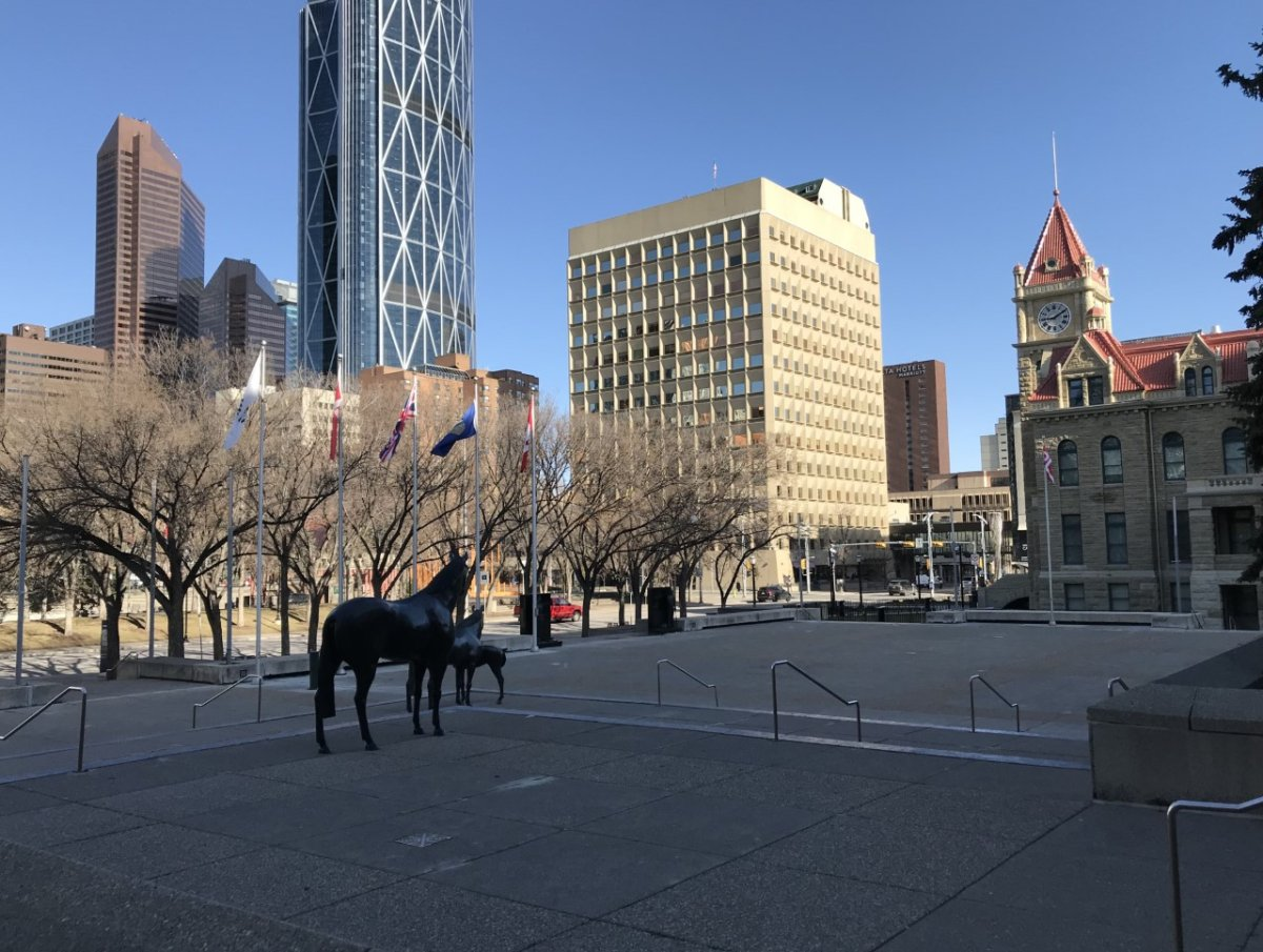 A view of Calgary's downtown with historic city hall, taken from the steps of the city's municipal building, pictured on April 26, 2021.