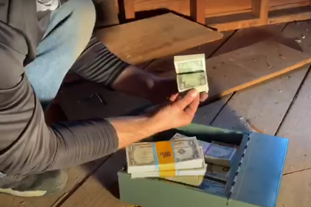 Treasure hunter Keith Wille shows off the cash he found in a New England home.