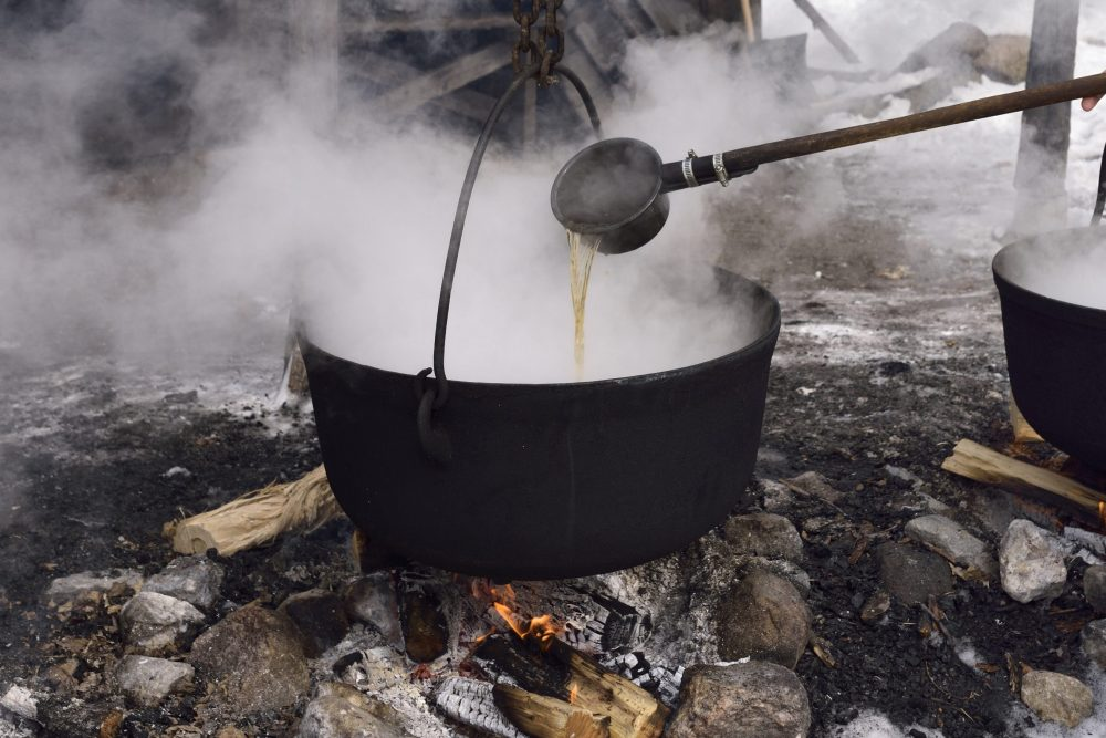 This file photo shows sap being boiled to make maple syrup.