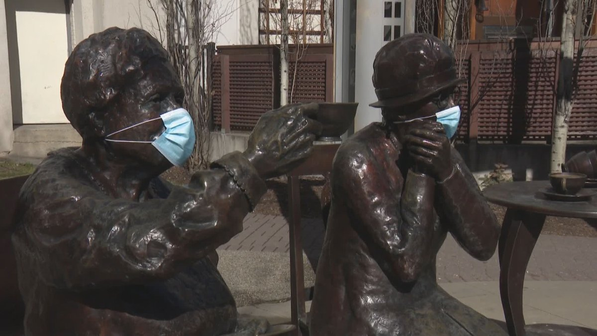 The Famous 5 Foundation is encouraging mask use in Calgary. Statues don masks on Wednesday, April 28, 2021.