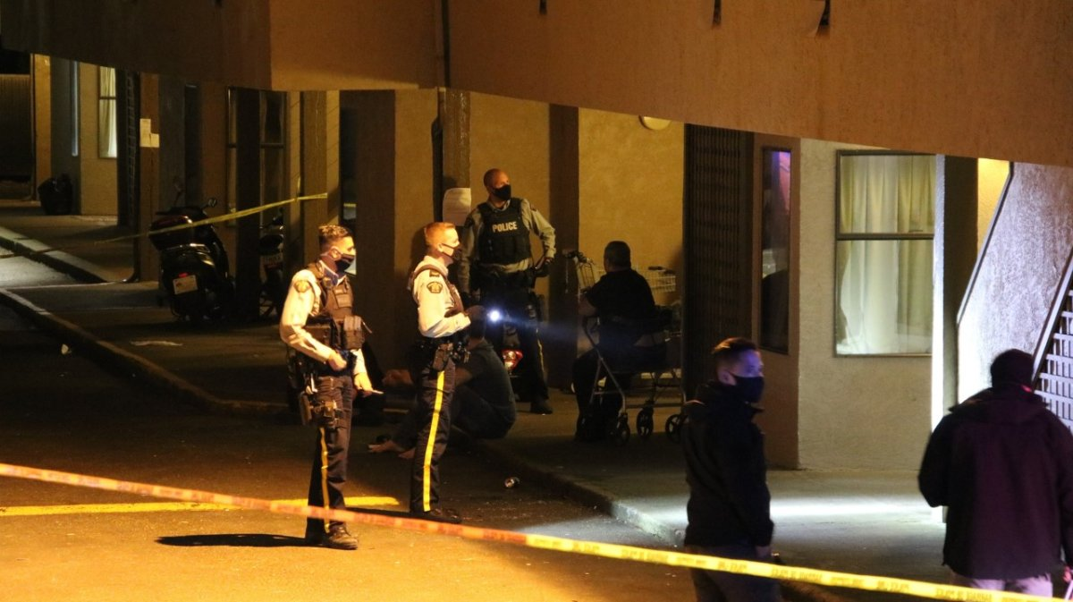 Surrey RCMP officers on scene of a shooting at a motel in Whalley Wednesday night.