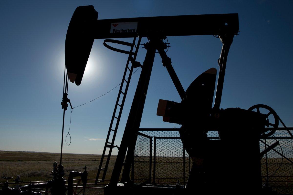 An oilfield pumpjack, belonging to Torxen, works producing crude near Brooks, Alberta on Sept. 11, 2020.  THE CANADIAN PRESS IMAGES/Larry MacDougal.