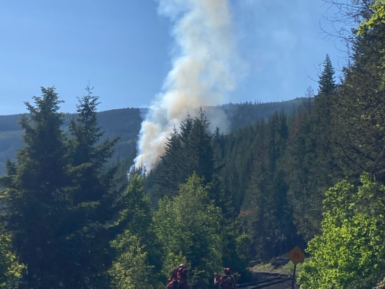Smoke rises from a wildfire burning near the Trans-Canada Highway in B.C.'s Southern Interior on Saturday. According to the B.C. Wildfire Service, the blaze is on the southwest side of Shuswap Lake and is currently not threatening any structures.