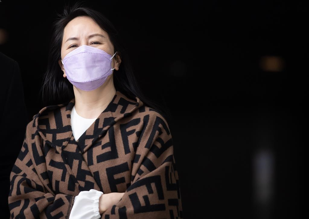 Meng Wanzhou, chief financial officer of Huawei, returns to B.C. Supreme Court after a break from her extradition hearing, in Vancouver, B.C., Wednesday, March 31, 2021. THE CANADIAN PRESS/Darryl Dyck.