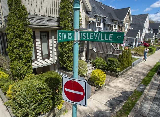 A sign marks Stairs Place in the Hydrostone district in the North end of Halifax on Thursday, May 13, 2021. The street was named for William Grant Stairs, a Canadian explorer from Halifax who helped lead some of the most controversial expeditions through the African continent. THE CANADIAN PRESS/Andrew Vaughan.