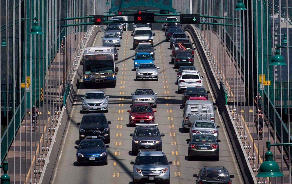 Traffic crosses over the Lions Gate Bridge from North Vancouver into Vancouver, B.C., on Thursday July 2, 2015. A project to deliver packages by cargo e-bike is about to launch in Vancouver as the city works to reduce pollution and traffic congestion. THE CANADIAN PRESS/Darryl Dyck.