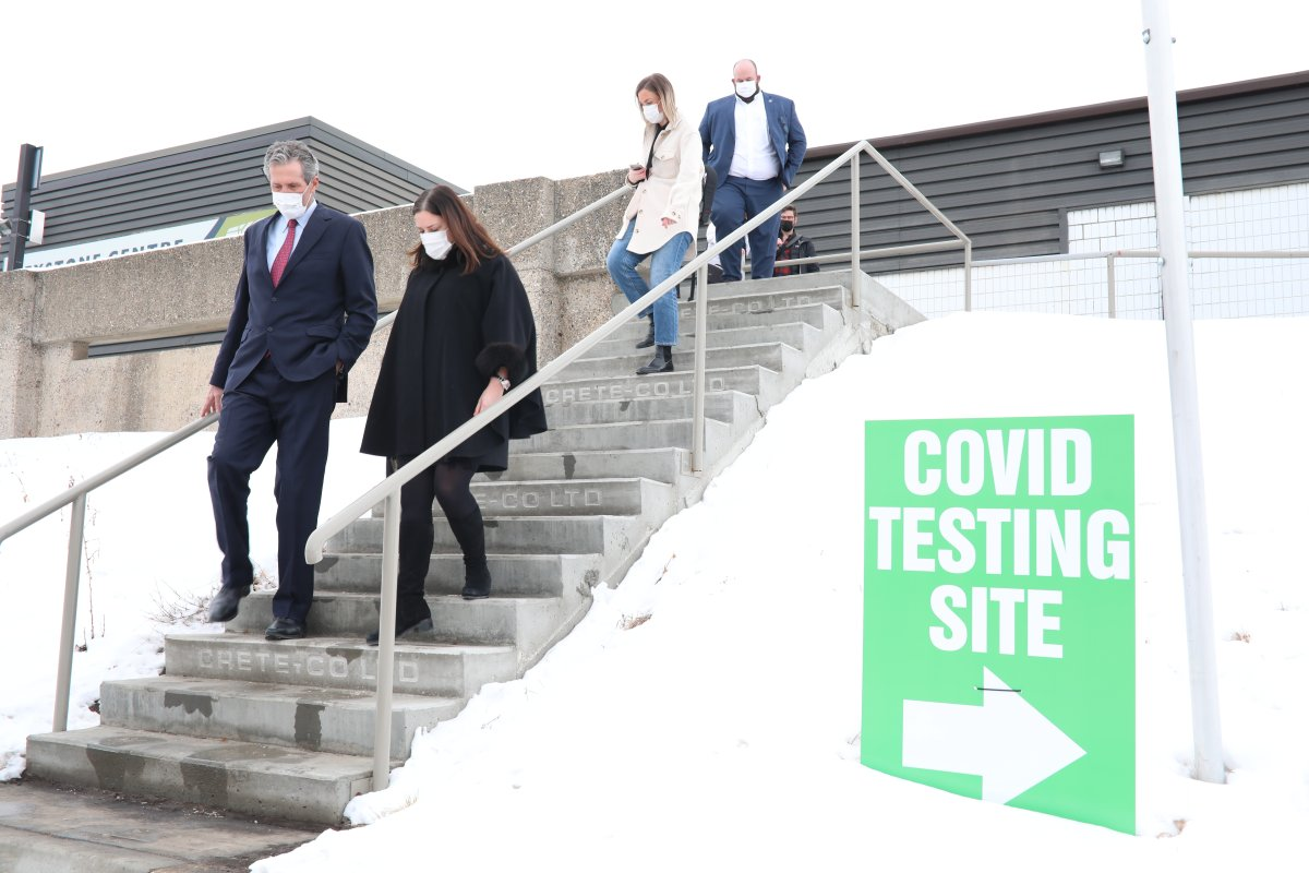 Manitoba Health Minister Heather Stefanson, second from right, walks with Premier Brian Pallister as they leave following a tour of the COVID-19 immunization supersite in Brandon. Stefanson says the province has been making plans to address rising cases and will reveal them soon.