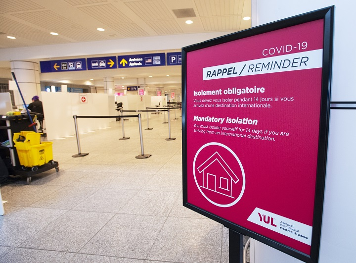 A sign reminds arriving passengers to quarantine against COVID-19 at Trudeau Airport in Montreal, Friday, Feb. 19, 2021.