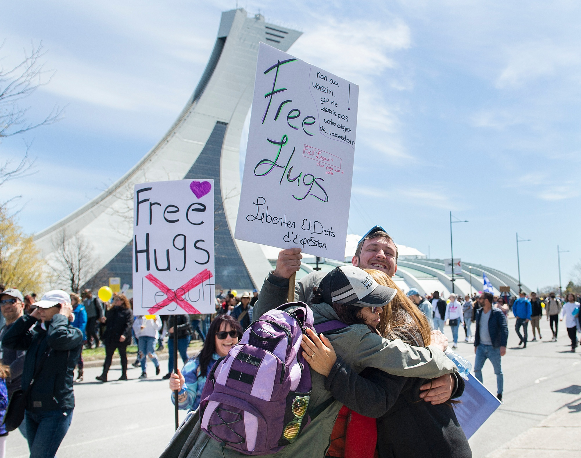 People hug as they take part in a demonstration opposing the Quebec government's health measures to help curb the spread of COVID-19 in Montreal, Saturday, May 1, 2021.
