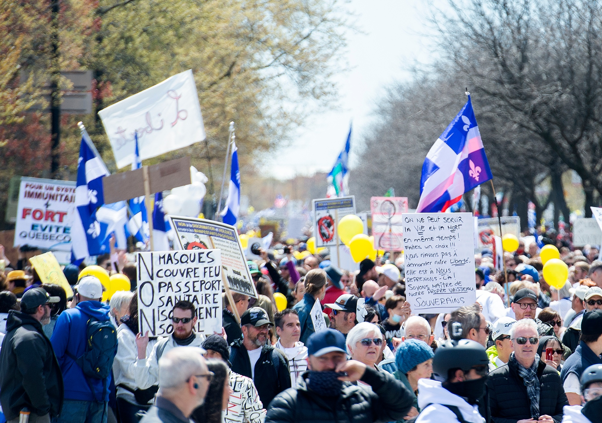 People take part in a demonstration opposing the Quebec government's measures to help curb the spread of COVID-19 in Montreal, Saturday, May 1, 2021.