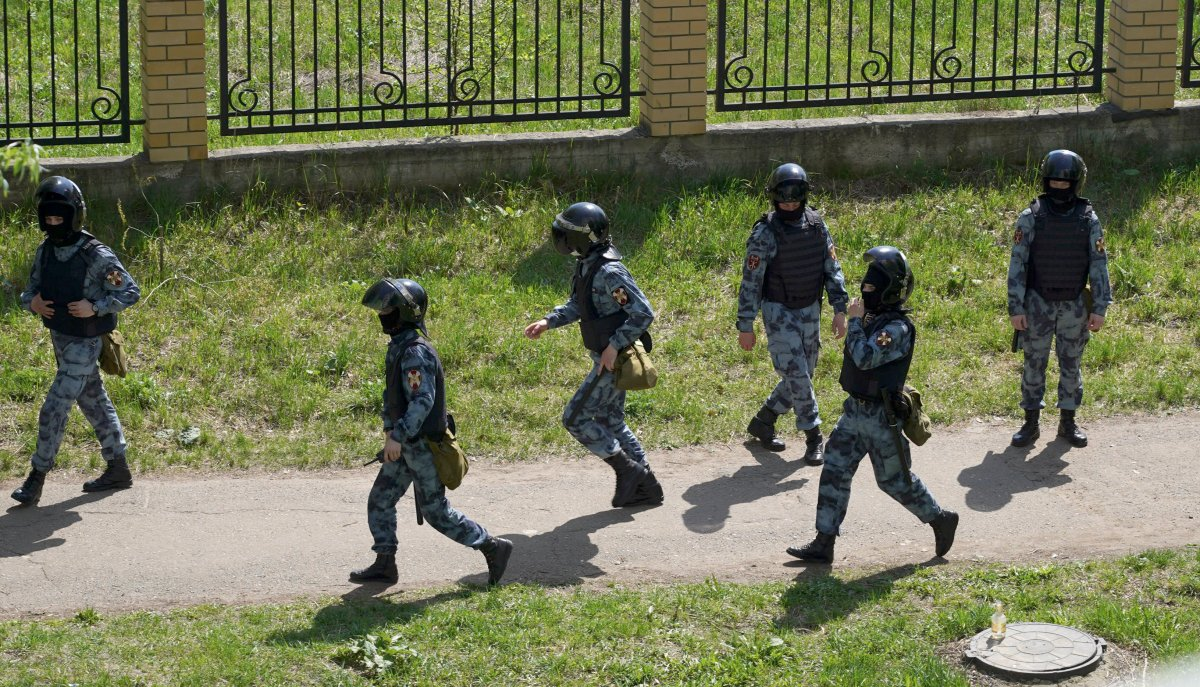 Security forces near the scene at a school after a shooting in Kazan, Russia, Tuesday, May 11, 2021.